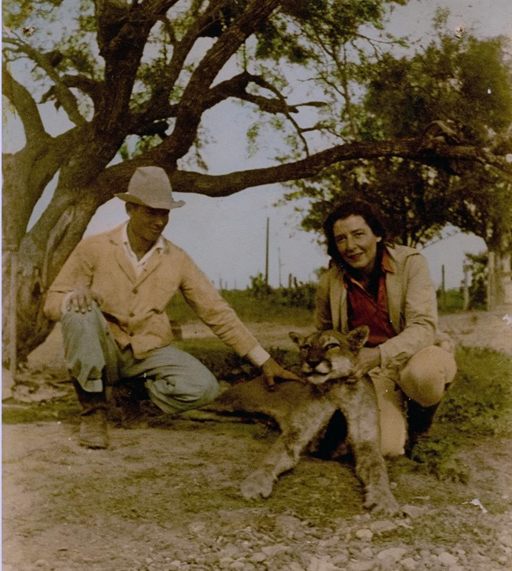 Photo from late 1930s. Alice G. Kleberg East posing at San Antonio Viejo with mountain lion.